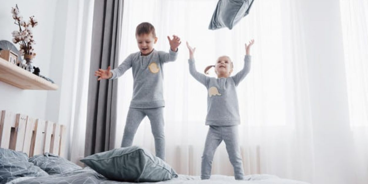 happy-kids-playing-white-bedroom-little-boy-girl-brother-sister-play-bed-wearing-pajamas-nightwear-bedding-baby-toddler-family-home_146671-15064