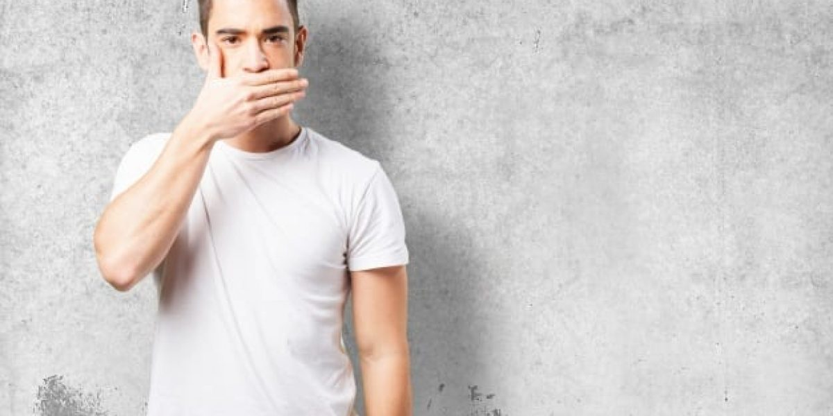 man-covering-his-mouth-with-his-hand_1187-2917